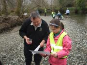 Checking the food supply is available in the Loch with national park rangers before releasing the Powan
