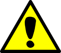 sign with a yellow background and black exclamation point