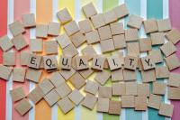 A photograph spelling the word 'equality' using scrabble pieces
