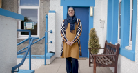 A piucture of Bute resident Rasha Rasho outside her place of work on the island