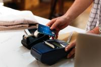 picture of a person using a credit card