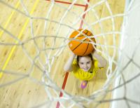 A school pupil playing basketball